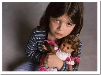 Sad little girl with doll