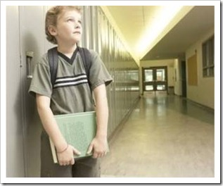 Boy in empty school corridor