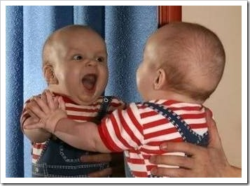 Excited baby in front of mirror