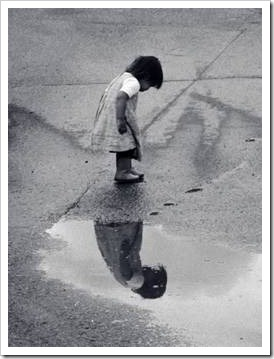 Little girl reflected in water