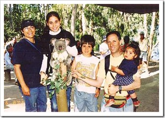 The Baras family and a koala