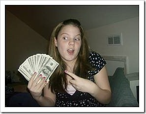 Teenage girl holding money