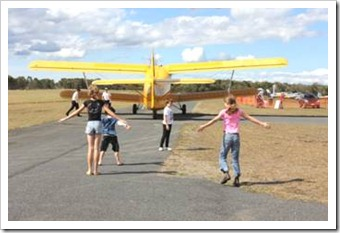 Kids running after a plane