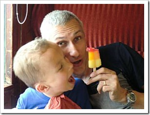 Father and son playing with popsicle