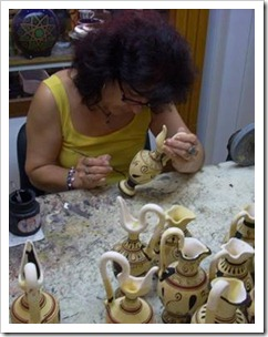 Woman drawing on pottery