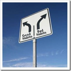 Road sign pointing to good habits and bad habits