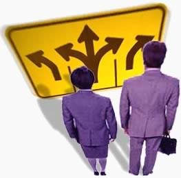 Couple in front of a sign with arrows in different directions