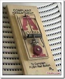 Mouse trap with complaint button