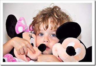 Sad little boy with Disney dolls