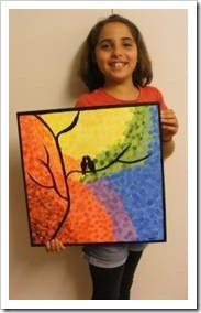 Girl holding a painting