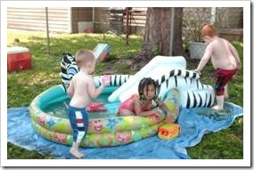 Children playing in a small pool