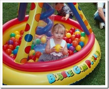 Little girl in a pool filled with balls