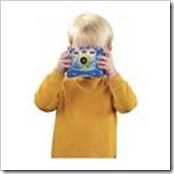 Little boy taking a picture
