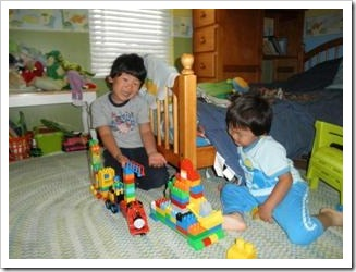 Two children playing with Lego