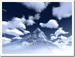 Icy mountain surrounded by clouds