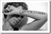 Compassion written on a woman's arm