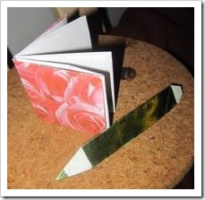 Wrapped book and pencil