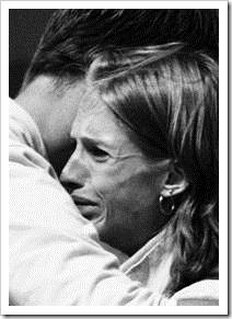 Man hugging a crying woman