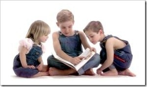 3 little children reading a book