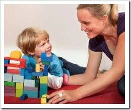 Mom and child playing with building blocks