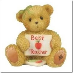 "Teddy with a sign saying ""best teacher"""