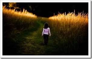 Girl walking through a field