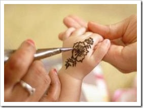 A baby hand with a henna tattoo