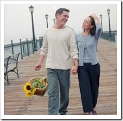 Couple walking along a pier