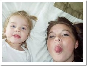 Baby and mum sticking tongues out