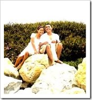 Couple sitting on some rocks