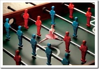 Foosball table with a ballerina as one of the players