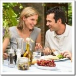 Man and Woman eating a meal in a vinyard