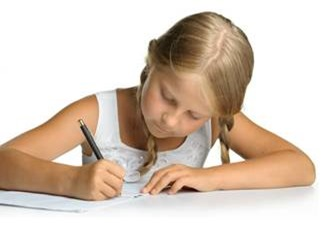 A girl writing on a page