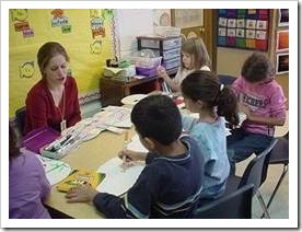 Teacher working wih a small group of children