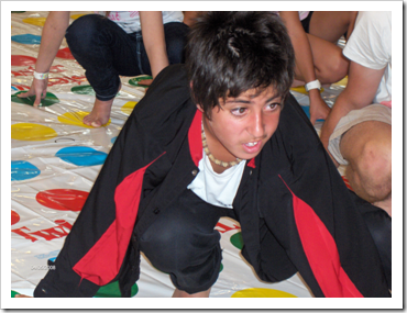 Teen boy playing twister