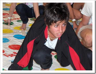 Teen boy playing twister