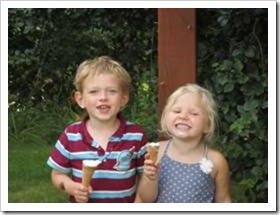 Boy and girl eating ice creams