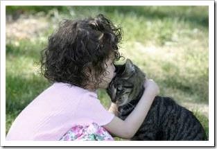Girl hugging a cat