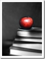 Apple on a stack of books