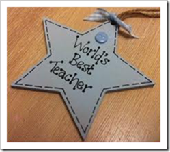 Star pendant with the words world's best teacher