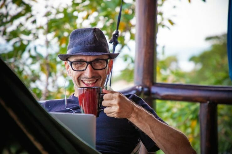 Man happy with cup of coffee