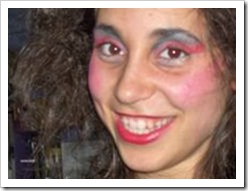 Teenager covered in stage make-up smiling into the camera
