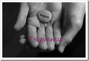 Palm holding a forgive stone