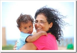 Woman hugging a baby and smiling