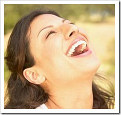 Woman laughing - she knows how to feel good