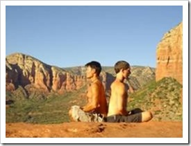 Two men meditating in the desert