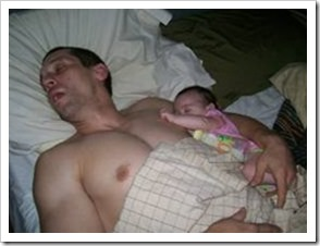 Father fast asleep with tiny baby daughter