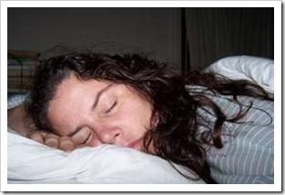 Woman in striped pyjama sleeping