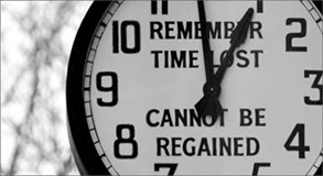 Remember time lost cannot be regained - written on a clock