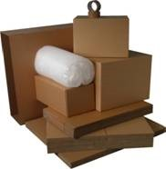 Different sizes of packing boxes and a bubble wrap roll